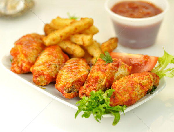 hot chicken wings with fried potatoes  Stock photo © saddako2