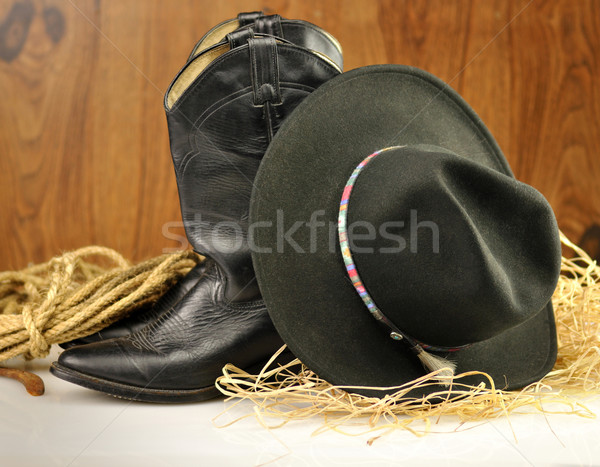 Preto chapéu de cowboy botas fundo couro país Foto stock © saddako2