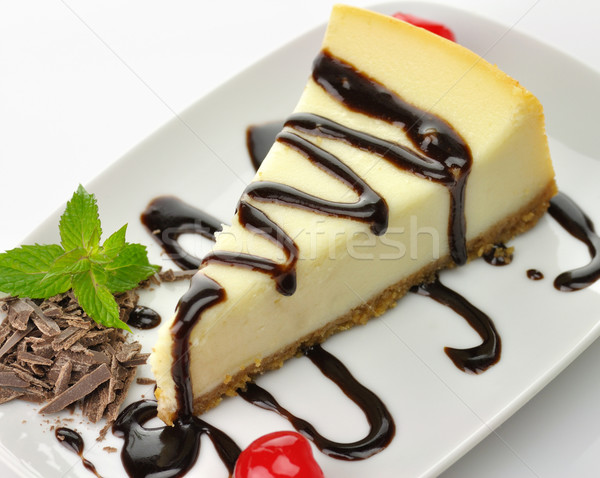 Stock photo: cheesecake with chocolate sauce