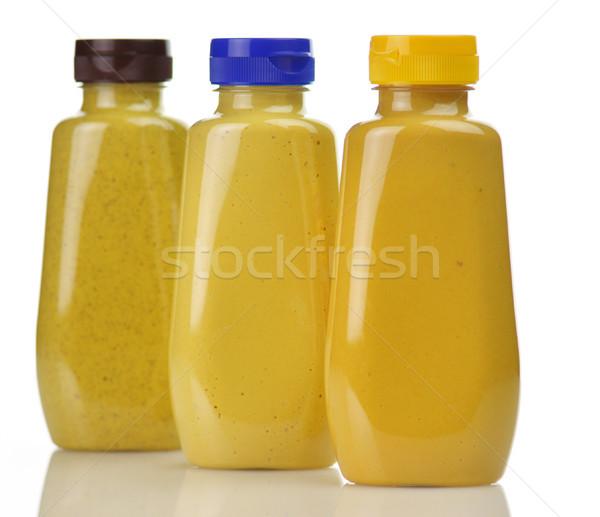 Mostarda plástico garrafas mel picante marrom Foto stock © saddako2