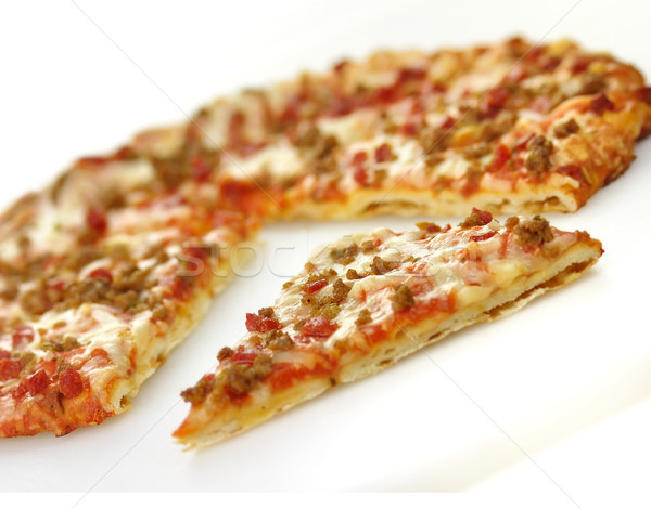 Stock photo: mini pizza  with sausage and pepperoni