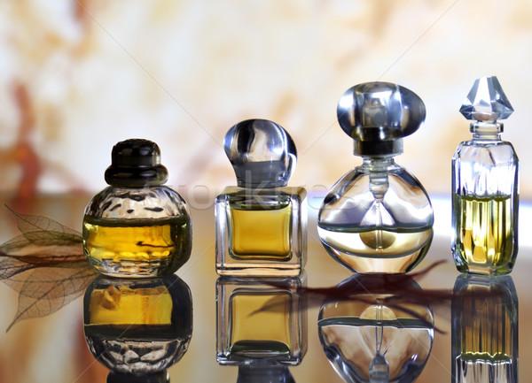Perfum kolekcja szkła tle butelki kobiet Zdjęcia stock © saddako2