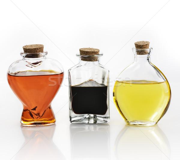 Olio d'oliva aceto vetro bottiglie olio bianco Foto d'archivio © saddako2
