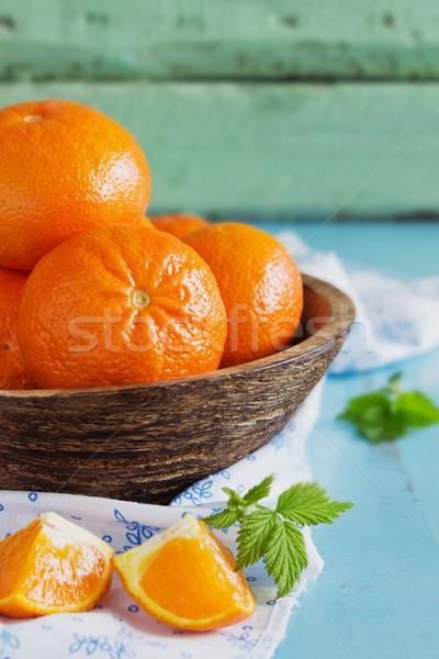 érett narancsok fából készült tál kék fa asztal Stock fotó © saharosa