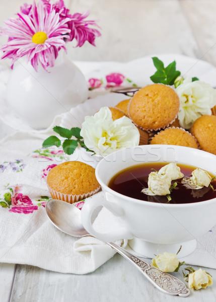 tea and cupcakes on the table Stock photo © saharosa