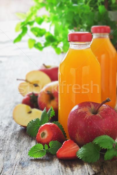 fruit juice, ripe apples and strawberries  Stock photo © saharosa