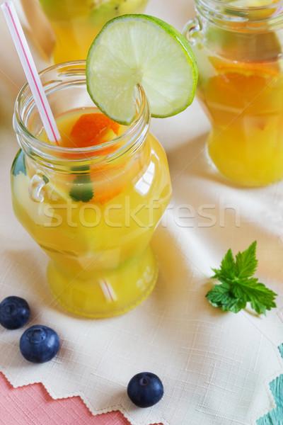 Pomarańczowy napój bezalkoholowy owoców tabeli górę widoku Zdjęcia stock © saharosa