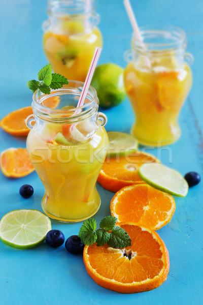 Narancs üdítőital szeletel citrus gyümölcsök kék Stock fotó © saharosa