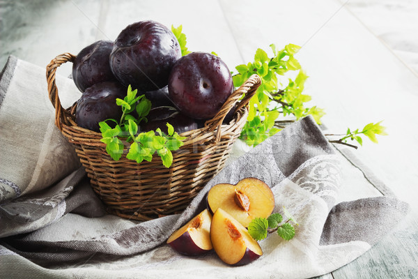 ripe plums in a basket Stock photo © saharosa