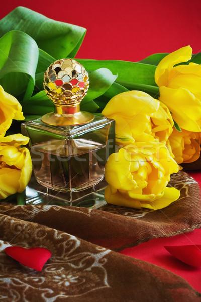 bottle of perfume and tulips Stock photo © saharosa