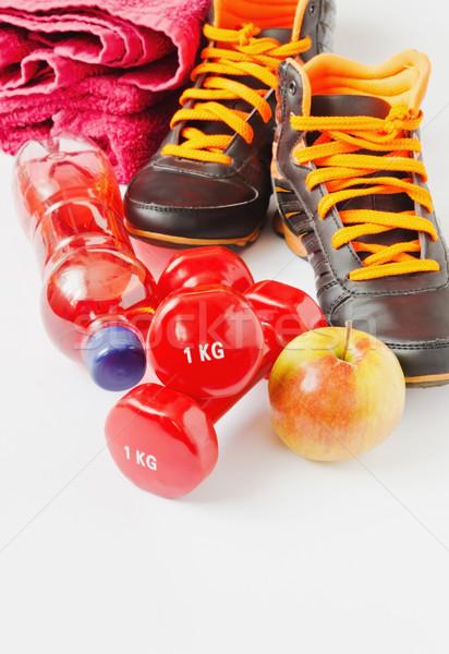 Spor sağlıklı beslenme spor ayakkabı meyve şişe Stok fotoğraf © saharosa