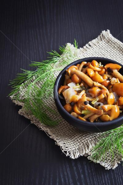Finom marinált gombák tál fekete fából készült Stock fotó © saharosa