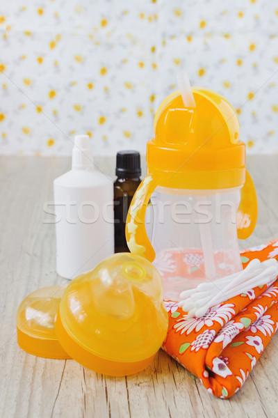пластиковых ребенка бутылку ухода белый цветами Сток-фото © saharosa