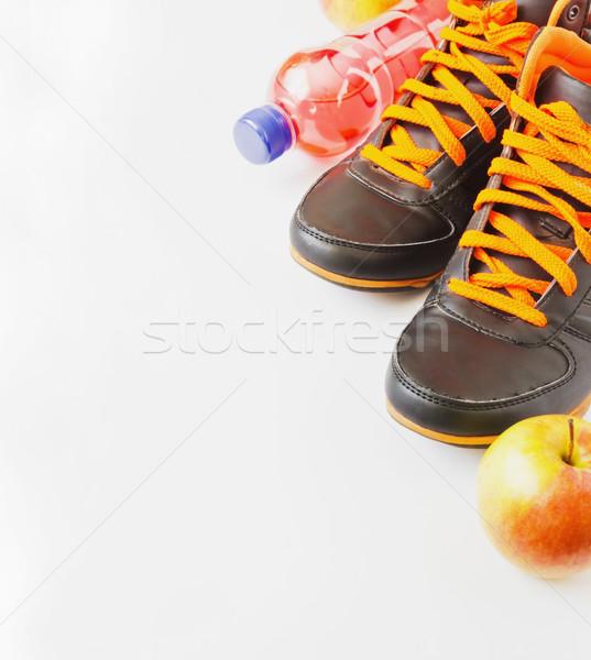 спорт спортивных обувь фрукты бутылку Сток-фото © saharosa
