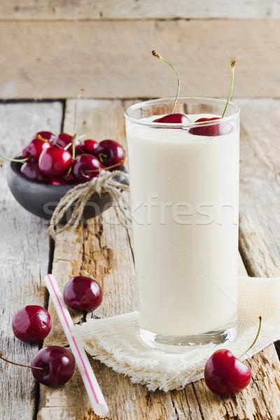 Yogurt cerezas frescos vidrio maduro Foto stock © saharosa