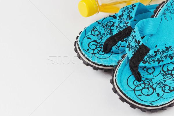 Tengerpart házi cipők üveg víz fehér egészség Stock fotó © saharosa