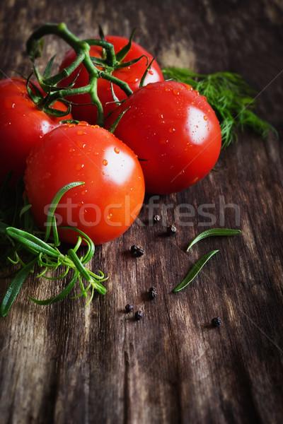 érett paradicsomok gyógynövények öreg fa asztal egészséges étel Stock fotó © saharosa