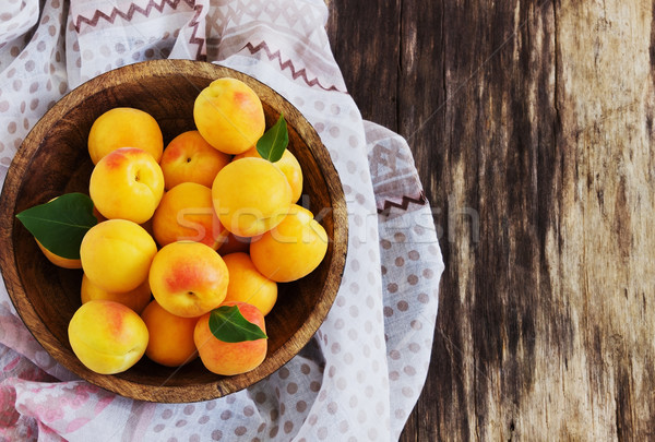 ripe apricots in a wooden bowl Stock photo © saharosa