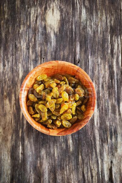 Kuru üzüm çanak eski ahşap diyet gıda Stok fotoğraf © saharosa