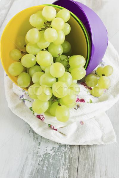 Maturo uve diverso colore plastica coppe Foto d'archivio © saharosa