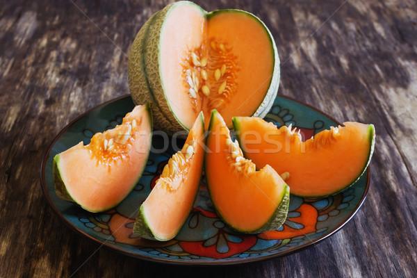 Maduro melón rebanadas edad mesa de madera salud Foto stock © saharosa