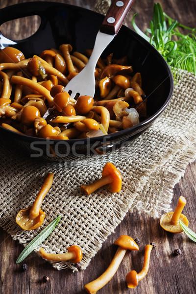Finom marinált gombák tál öreg fából készült Stock fotó © saharosa