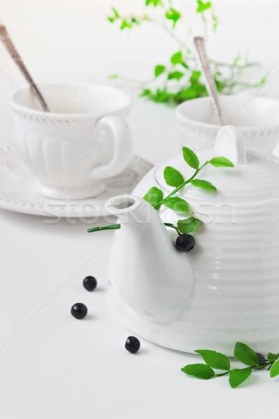 Blanco tetera taza arándanos mesa edad Foto stock © saharosa