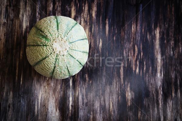 Küçük çizgili kavun organik ahşap masa Stok fotoğraf © saharosa