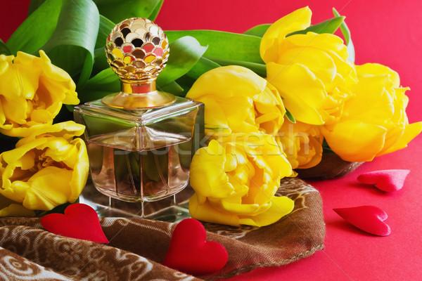 Botella perfume tulipanes rojo festivales acontecimientos Foto stock © saharosa