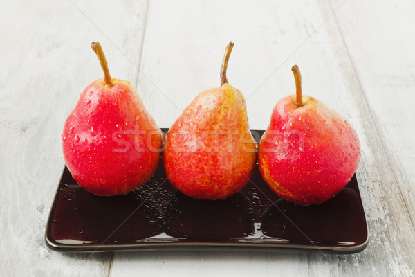 Tres maduro peras sabroso negro placa Foto stock © saharosa