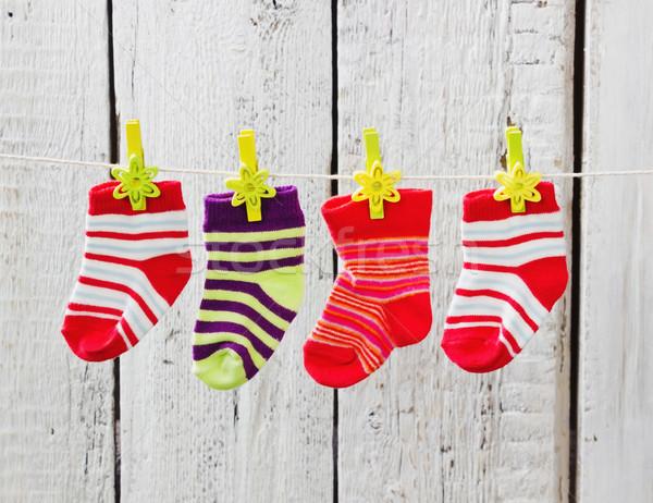 A rayas calcetines colgante cuerda blanco Foto stock © saharosa