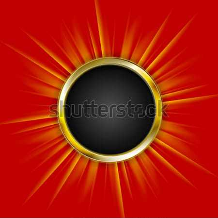 Golden circle and beams on red background Stock photo © saicle
