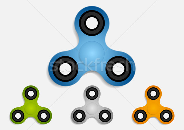 Set of hand fidget spinner toys for stress relief Stock photo © saicle