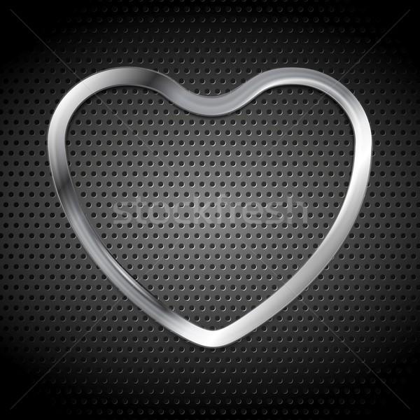 Metallic heart on perforated background Stock photo © saicle