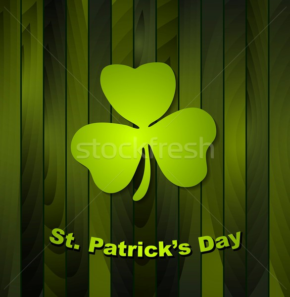 Clovers shamrock on green wooden background Stock photo © saicle