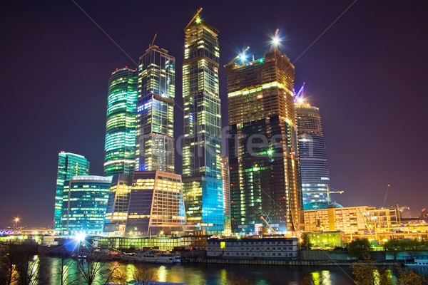 Skyscrapers at nighttime Stock photo © sailorr