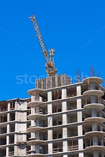 Modern társasház építkezés kék ég iroda ház Stock fotó © sailorr
