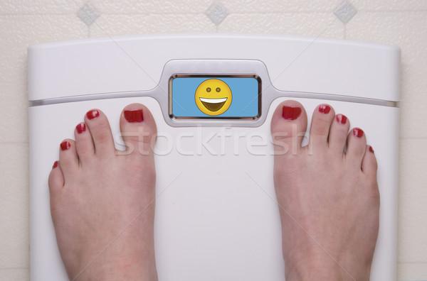 Schaal voeten gelukkig digitale glimlach Stockfoto © saje