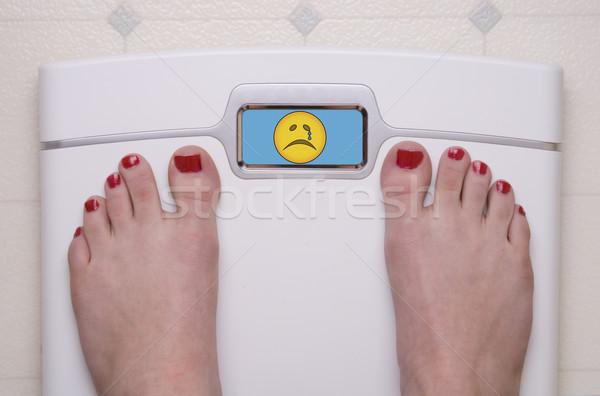 ölçek ayaklar üzücü dijital yüz Stok fotoğraf © saje