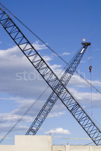 Construction Cranes Crossed in an X Stock photo © saje