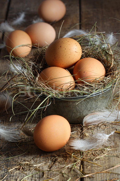 Fresh brown eggs on wood background Stock photo © Sandralise