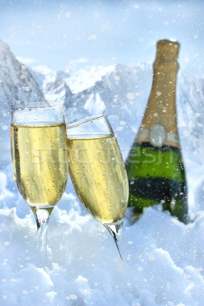 Two glasses of champagne with bottle in snow Stock photo © Sandralise