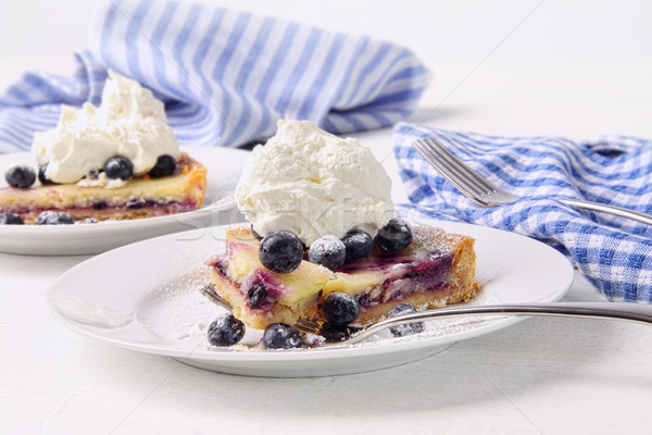 Blueberry lemon tart with whip cream on wood table Stock photo © Sandralise