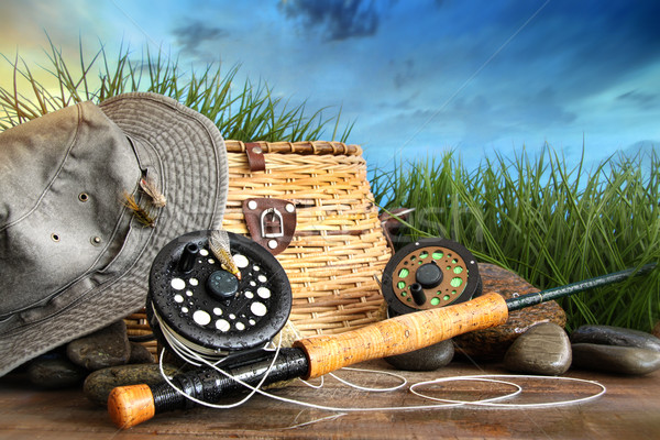 Fly fishing equipment with hat on wooden dock Stock photo © Sandralise