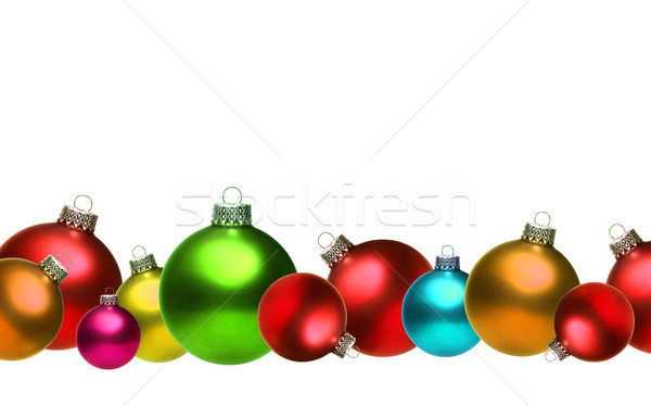 Stock photo: Colored christmas glass balls isolated on white