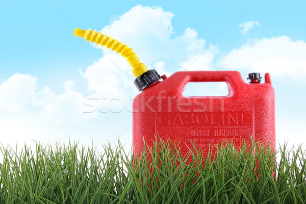 Plastic gas can in grass against white  Stock photo © Sandralise