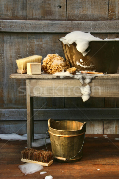 Old wash tub with soap and scrub brushes Stock photo © Sandralise