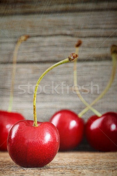 Red cherries on barn wood Stock photo © Sandralise