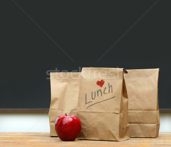 Lunch bags with  apple on school desk Stock photo © Sandralise
