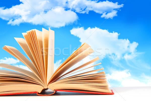 Stock photo: Open book against a blue sky